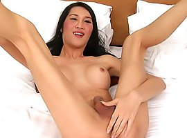 Tall slim ladyboy model tosses her cock