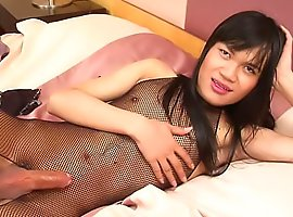 Wild Asian shemale wanks in her bodystocking