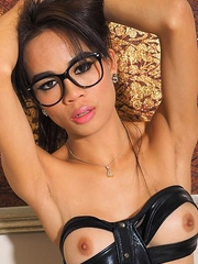 Ladyboy Dada, shows whos in control while wearing PVC that shows off her hard cock and perfect tits.